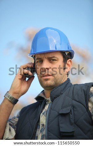 foreman in construction site making a call - stock photo