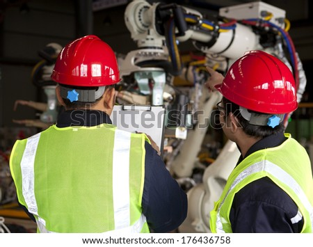 Foreman inspection in manufacturing factory - stock photo