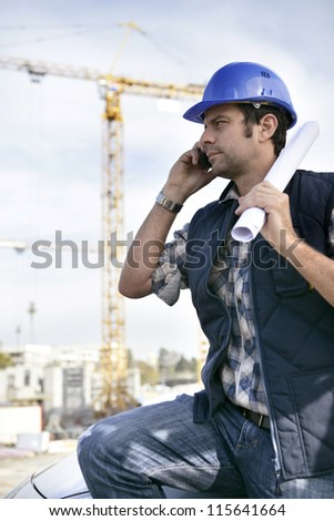 Foreman stood with site in the background - stock photo