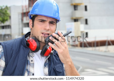 Foreman with a walkie talkie - stock photo