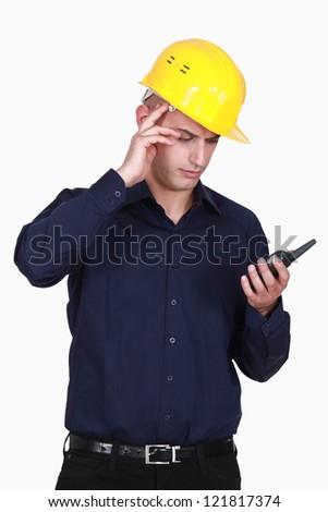 Foreman with walkie talkie - stock photo