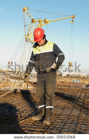 foreman worker in workwear at construction site - stock photo