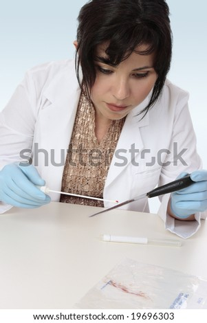 Forensic investigator takes a sample from a knife for further analysis