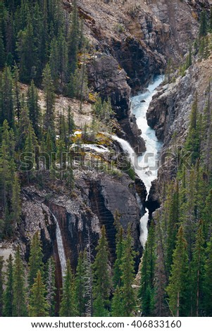 Forest and waterfall in Banff National Park, Canada - stock photo