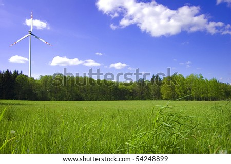 Forest and windmill conceptual image. Picture windmill and green forest in summer. - stock photo
