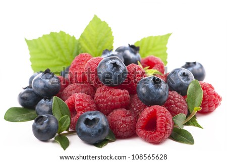 forest berries, Many blueberries & raspberries. Isolated white - stock photo