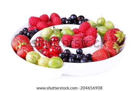 Forest berries on plate, isolated on white