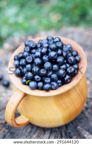 Forest blueberries in a large, wooden bowl - stock photo