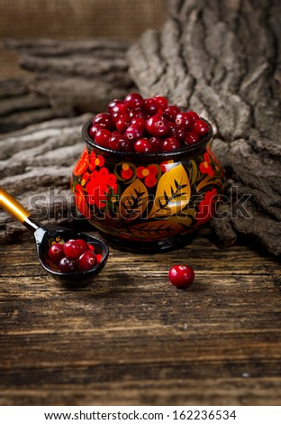 Forest cranberries in a traditional Russian painted bowl - stock photo