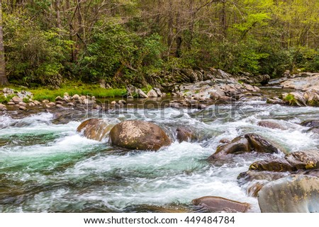 Forest creek. Water cascades over rocks in Great Smoky Mountains National Park. - stock photo
