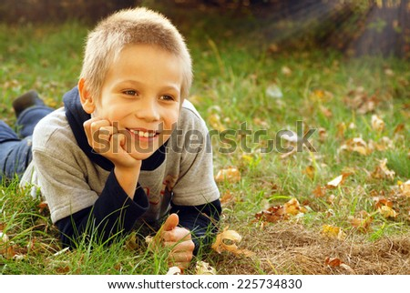 Forest, cute boy lying on leaves