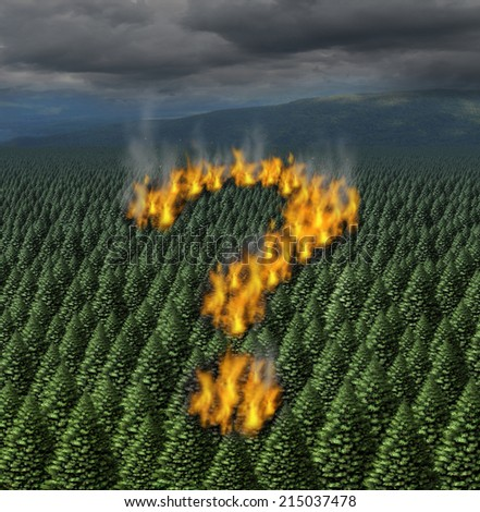 Forest fire concept as a raging wildfire burning a forest of trees shaped as a question mark as a symbol for safety information during a dry heat weather period causing an environmental disaster. - stock photo