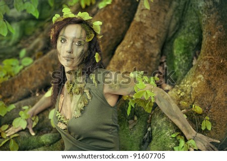 Forest girl in front of a beech-tree - stock photo