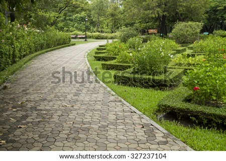 Forest green light during the day in the park - stock photo