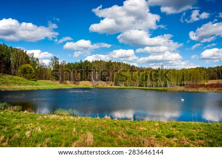 Forest lake. Beautiful lake in the forest, Masuria. Poland - stock photo
