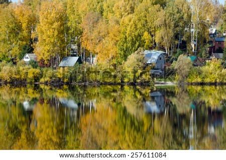 Forest lake in sunny autumn day in Siberia - stock photo