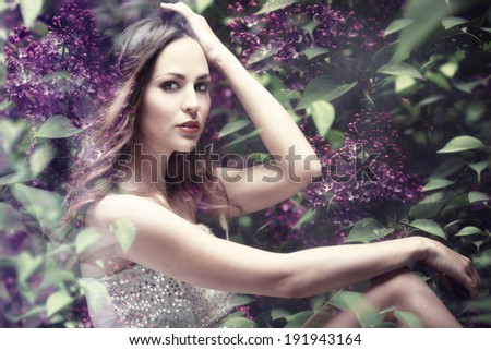 forest nymph in lilac flowers, composite photo - stock photo