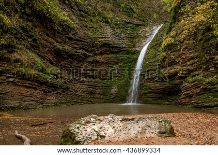 Forest waterfall in the fall - stock photo