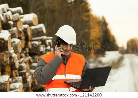 Forester with the computer and the telephone - stock photo