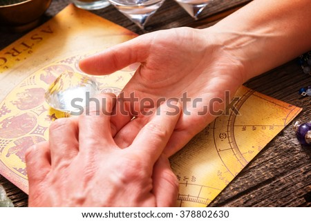 Foretelling the future through the study of the palm and astrology - stock photo