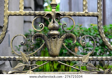 Forged decorative iron fence details.