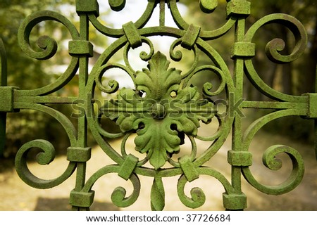 forged gate  metallic patterns  screw-thread - stock photo