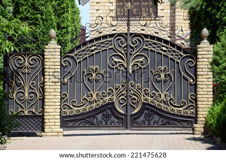 Forged gates and gate. Front of the house. - stock photo