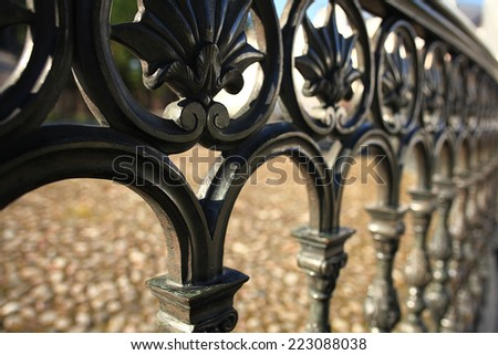 forged lattice fence in the city - stock photo