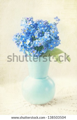 Forget me not flowers in a vase - stock photo