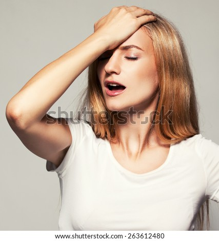 Forgetful woman. Female engaged in self-flagellation - stock photo