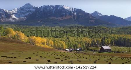 Forgotten farm in autumn. - stock photo