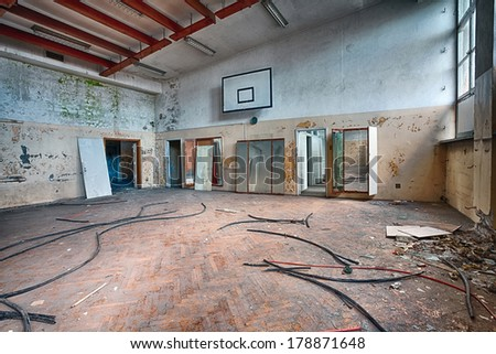 Forgotten gym in a ruined building - stock photo
