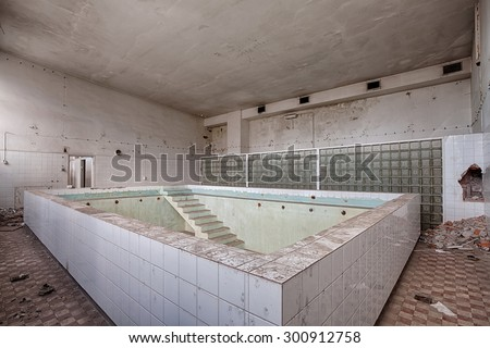 Forgotten pool in an abandoned hospital - stock photo