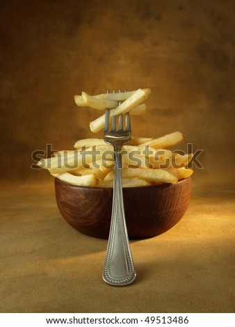Fork and chips - stock photo