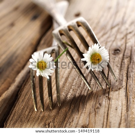 fork and flowers  - stock photo