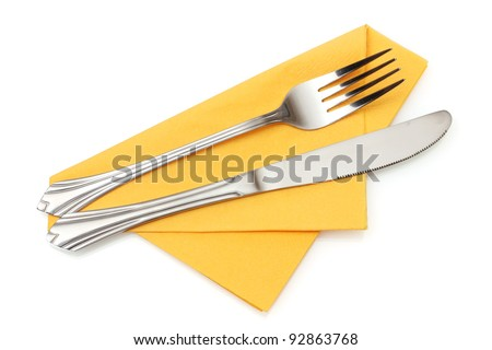 Fork and knife in a yellow cloth isolated on white - stock photo