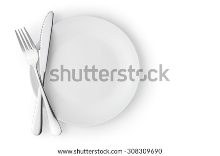 Fork and knife on a empty plate - stock photo