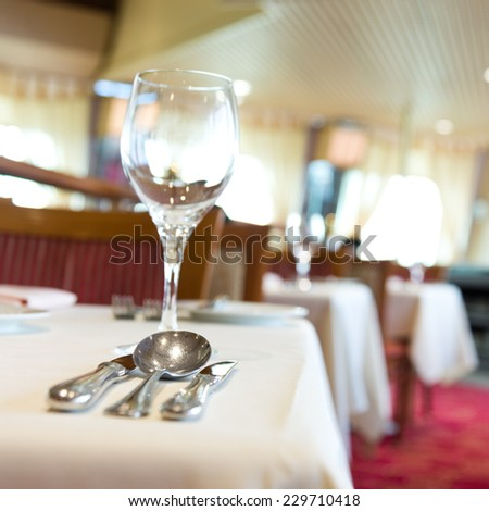 fork and knife on a napkin with plate. - stock photo