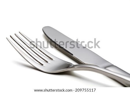 Fork and knife on a white background.