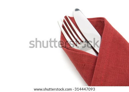 fork and knife on red napkin isolated on white background.