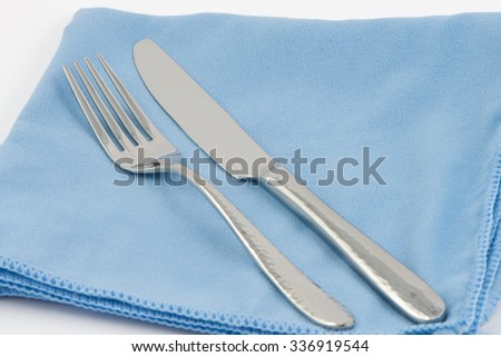 Fork and Knife on the Cloth  - stock photo