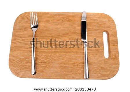 fork and knife on the wooden desk - stock photo