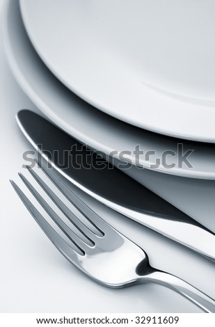 fork and knife, plate,dual tone - stock photo