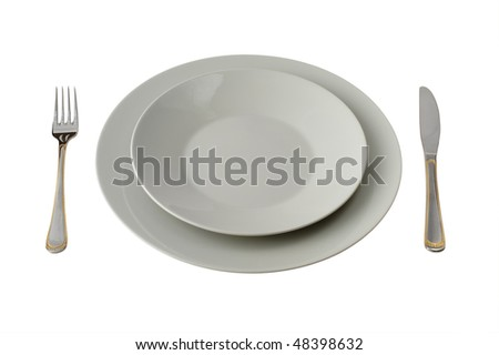 Fork And Knife With Two Plates Isolated On White Background
