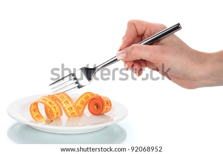 Fork and measuring tape in hand and plate isolated on white - stock photo