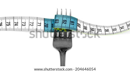 Fork and measuring tape on white background  - stock photo