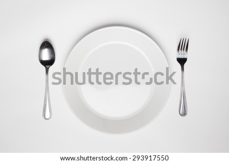 fork and spoon and empty plate