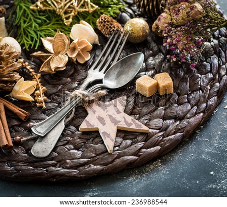 fork and spoon with Christmas decorations on the table - stock photo