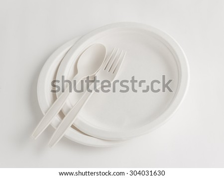 Fork and spoon with disposable paper plate for party - stock photo