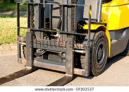 Fork carriage of a forklift truck - stock photo